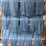 indigo dyed yarn on clothes drying rack