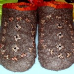 Felt booties based on extant Altaic examples. Booties are made of natural colored icelandic wool felt that was flat felted. The felt was cut into the bootie pattern and stitched together by hand.