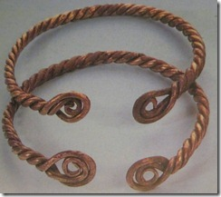 Coiled terminal wire bracelets conquest era graves