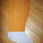Leggings cut and constructed  from a pattern based on a find at Moscevaya Balka. The foot portion is cut from heavy linen canvas. The uppers are made from hand woven woolen fabric. Seams are completely turned under and finished.