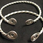 Reproduction Silver coiled terminal wire bracelets based on 10th century hungarian grave finds.