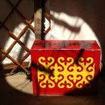 The is one of a pair of plainly constructed wooden boxes that I painted several years ago.  The designs are traditional khazak positive/negative motifs.  I thought this photo of the box in the light of the roof ring came out well.