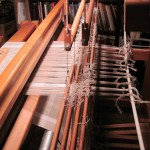 The loom at the end of the linen warp.