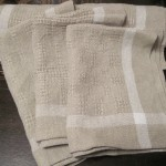 The finished linen towels after weaving, washing,drying, pressing and hemming.