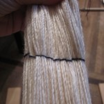 These are ties every 10 threads.  I use this method to count the number of passes I've completed on the warping board.