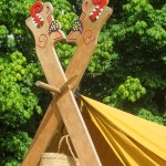 These tent poles were hand carved and painted by a good friend of ours.  It seemed a shame that they weren't being seen.