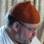This naalbind hat is the first hat I've made.  I used madder hand dyed Lopi 100% wool yarn.