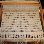 The patterned gauze weave sample on the loom.
