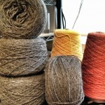 The yarn I will be using for this project.  The gray alpaca wool is for the main body of the mantle.  The orange and yellow wool is for cardwoven embellishment.