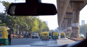 Leisurely driving in Delhi.  The yellow and green vehicles are tuk tuks.