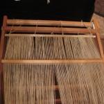 Half-threaded through the rigid heddle